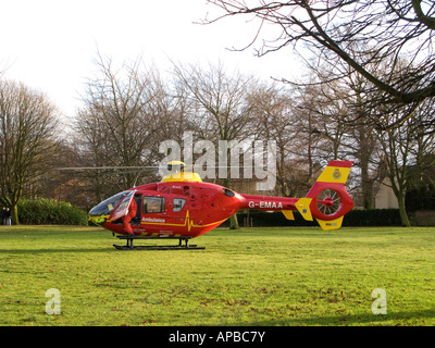 Paramedic getting out of county air ambulance in public park - Stock Photo