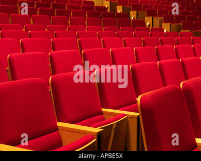 United Kingdom Manchester rows of empty red seats in an auditorium - Stock Photo