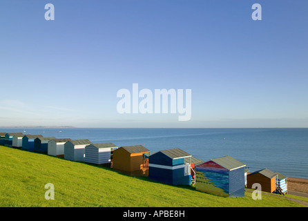 Beach huts overlooking the sea at Tankerton near Whitstable Kent England - Stock Photo