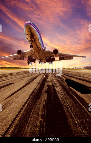 A wide body commercial airliner takes off from the airport runway - Stock Photo