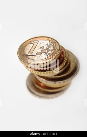 Leaning pile of Euro coins --- european currency, Europe, money, finance - Stock Photo