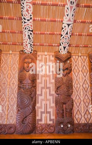 Maori carved wood design detail inside Whare runanga marai Waitangi meeting house in Treaty Grounds National Reserve - Stock Photo