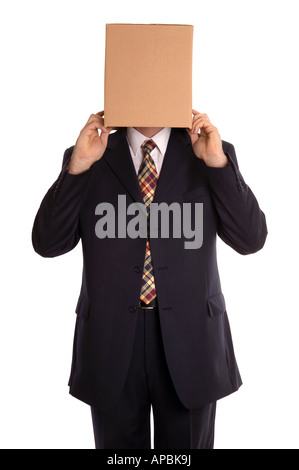 Businessman about to reveal himself from his hidden identity - Stock Photo