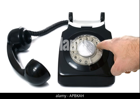 Number being dialled on an old black telephone - Stock Photo