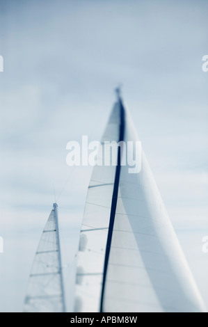 sailboat under sail  in calm seas and light wind sailing cruising yacht vertical  trip journey travel holiday vacation - Stock Photo