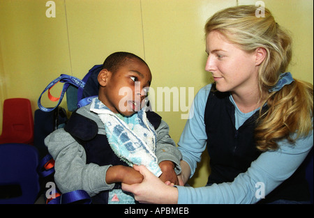 Autistic child with carer at a special school, Southwark, London, UK. - Stock Photo