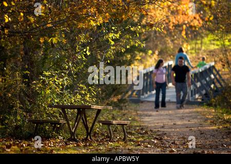 Outdoor enthusiasts walk the Tanyard Creek Trail in Bella Vista, Ark. - Stock Photo