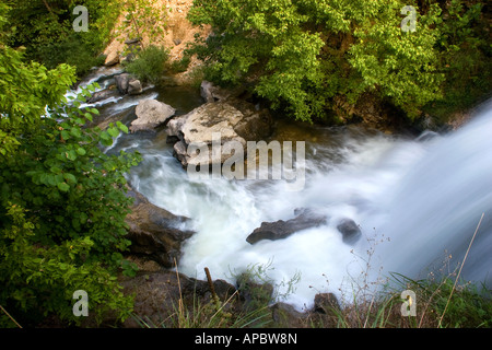 Water rushes over a waterfall along the Tanyard Creek Trail in Bella Vista, Ark. - Stock Photo
