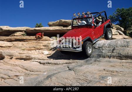 Fourwheel drive vehicle on a rocky track near Moab, Utah, USA - Stock Photo