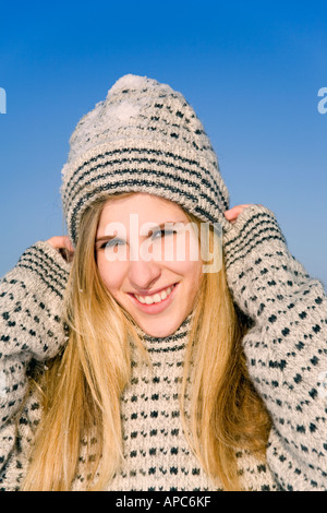 A young woman with a woolen sweater on a winter day - Stock Photo