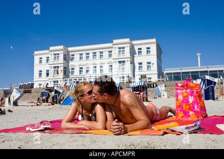 Couple on the beach, Norderney Island, Eastern Frisia Islands, Germany - Stock Photo