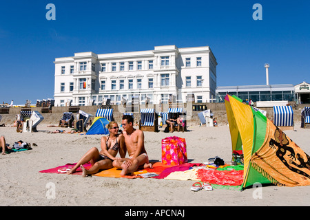 Couple on the beach, Norderney Island, Eastern Frisia Islands, Germany - Stock Photo