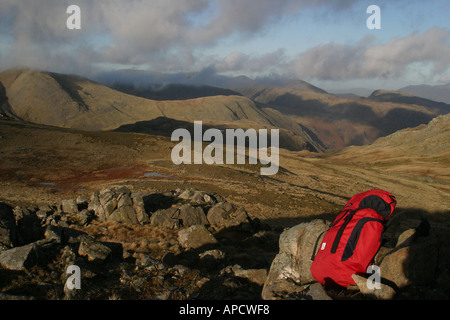 rucksack left on top of a mountain in the lake district - Stock Photo