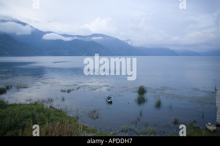 GUATEMALA LAKE ATITLAN Fishermen in cayucos small boats made of avocado wood - Stock Photo