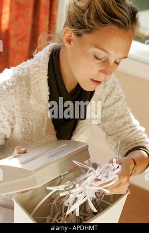 woman using shredder - Stock Photo