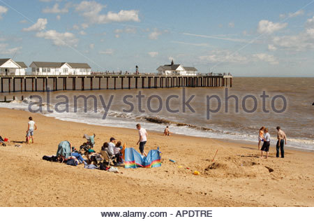Holiday makers on the beach and the Pier at Southwold, Suffolk England - Stock Photo