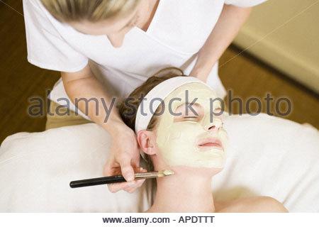 Woman receiving facial spa treatment - Stock Photo