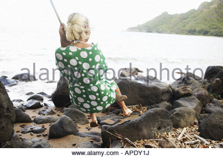 Young woman on rope swing - Stock Photo