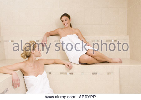 Two women sitting in sauna - Stock Photo