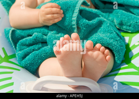 Close up of baby's bare feet - Stock Photo