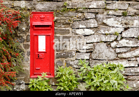 Victorian red post box set in a stone wall at Crickadarn Powys Mid Wales UK - Stock Photo