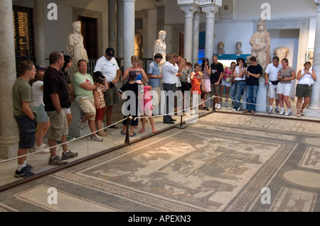 Tourists looking at Roman mosaics in the museum of Bardo, in Tunis, Tunisia. - Stock Photo
