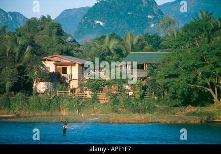 Fishing with nets on the Mekong River Vang Vieng Laos - Stock Photo