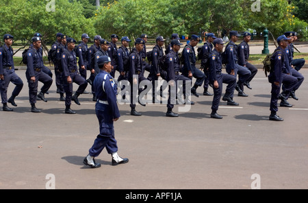 Indonesian police officers in central Jakarta practising marching and saluting, Indonesia. - Stock Photo