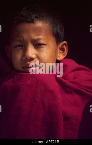 Boy monk Bodhnath Buddhist temple Kathmandu Nepal Asia - Stock Photo