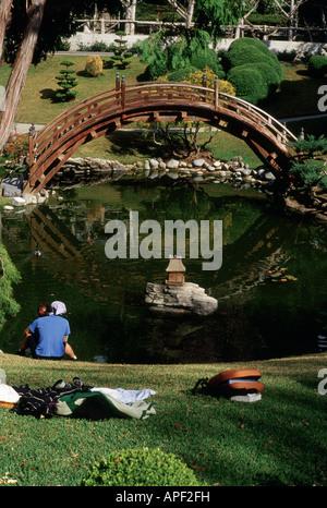 Japanese garden with moon bridge and lotus pond, Huntington Botanical Gardens, San Marino, California - Stock Photo