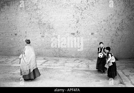 Xiahe monks playing football Xiahe Gansu Province People s Republic of China - Stock Photo