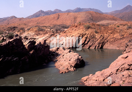 The Kunene River forming the border between Namibia and Angola. - Stock Photo