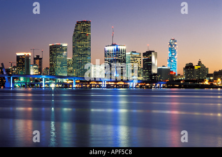 Downtown Miami Florida over Biscayne Bay at dusk - Stock Photo