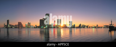 Miami Florida reflected in calm Biscayne Bay before dawn - Stock Photo