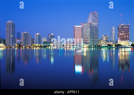 Miami FL reflected in calm Biscayne Bay before dawn - Stock Photo