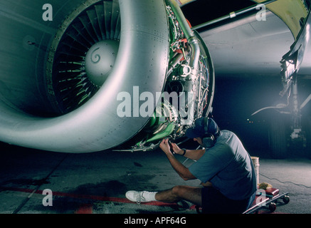 Engine of a 737 aircraft being worked on - Stock Photo