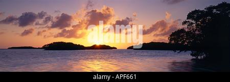 Sun sets beyond mangrove islands on Florida Bay Everglades National Park Florida - Stock Photo