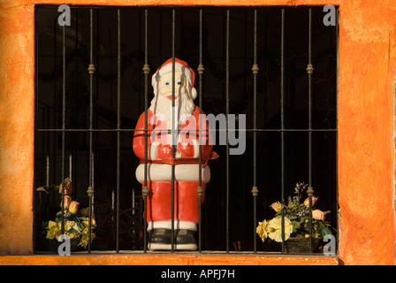 Santa Claus figure in window of Marcos II restaurant Bucerias Nayarit Mexico - Stock Photo