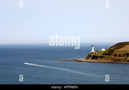 Boat leaving the mouth of Campbeltown Loch, Kintyre Scotland, UK - Stock Photo