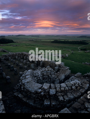 Sunrise over Housesteads Fort on Hadrians Wall in Northumberland National Park - Stock Photo