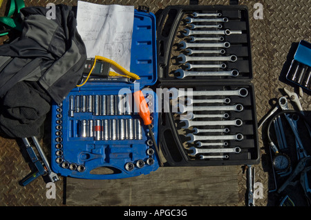 Socket wrenches and box wrenches in storage boxes - Stock Photo