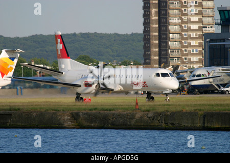 Saab 2000 passenger aeroplane taxiing at London City Airport London UK - Stock Photo