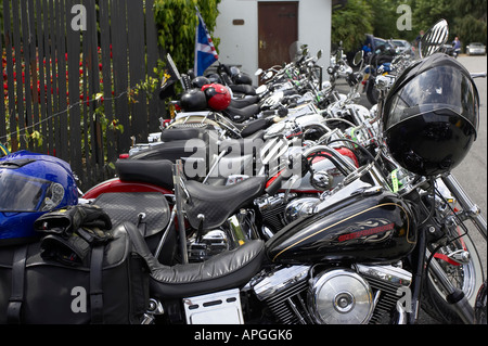 row of tanks and seats of harley davidson motorcycles stock photo