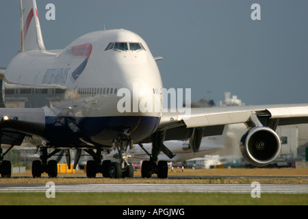 Boeing 747 436 of British Airways taxiing for departure at London Heathrow Airport - Stock Photo