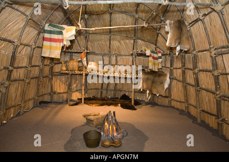 ILLINOIS Rockford Interior of wigwam Native American house plains Indians blankets pots and animal skins - Stock Photo