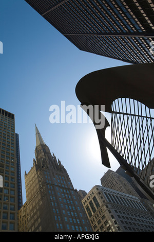 ILLINOIS Chicago Outline of untitled sculpture by Pablo Picasso in Daley Plaza blue sky top of office buildings - Stock Photo