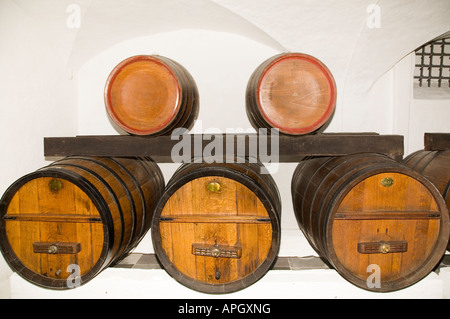 oak wine barrels. wine ages in a cellar with traditional oak barrels stock photo