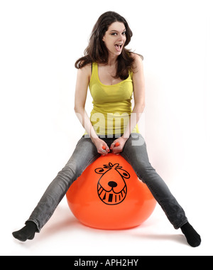 Young female on a space hooper - Stock Photo