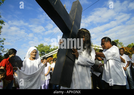 A Filipino portraying Jesus Christ leads a Good Friday procession in Mansalay, Oriental Mindoro, Philippines. - Stock Photo