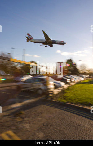 British Airways Boeing 777-236ER coming to land on runway 27L at London Heathrow Airport UK - Stock Photo